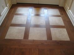 This is how I want our entry way to look with the tile and wood flooring. Can we do it?