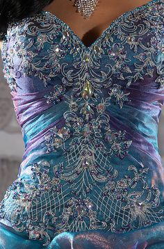 Close up on the front of the peacock wedding dress. More
