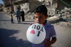 boy with balloon in Douma, Syria,  Reuters / Bassam Khabieh