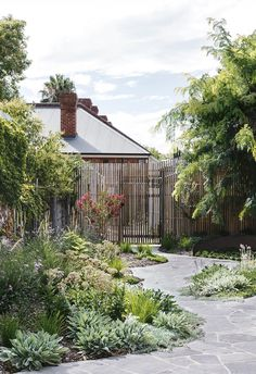 A meandering path links a series of spots for entertaining and exploring in this Adelaide garden inspired by art. Beautiful layered garden beds with curved crazy paving path. Cottage Garden Plants, Garden Spaces, Garden Beds, Garden Path, Garden Design Plans, Path Design, Landscape Design, Australian Garden Design, Australian Native Garden