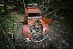 In the backyard of the Château Lumière an old, red Deux Chevaux slowly rusts and decays. With the bent out doors it almost looks like a dying bug with broken… Broken Wings, The Ch, Urban Exploration, Urban Decay, Explore, Photography, Photograph, Photography Business, Photoshoot
