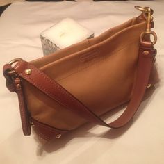 Coach leather small purse Good condition inside like new one zipper package one small packets size 10x6x2/5 inches so nice purse Coach Bags Mini Bags