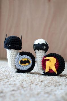 It's Batsnail and his sidekick Robin! Aka Tim...
