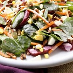Loaded Spinach Salad - Ingredients: 8 hard-boiled eggs, 6 c fresh baby spinach, 4 tbsp blue cheese dressing, 1 can beets, 1 c shredded carrots, 2 tbsp chopped toasted pecans. Prep: Peel the eggs, discard 6 of the yolks, chop the remaining yolks & whites. Toss spinach with 2 tbsp dressing in a large bowl. Divide between 2 plates. Top with chopped eggs, beets, carrots and pecans. Drizzle with the remaining 2 tbsp dressing. Serves 2.