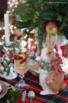 Christmas table with tartan, greenery and Fitz and Floyd bunnies | homeiswheretheboatis.net #tablescape