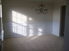 Dining room with picture frame moulding