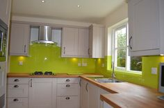 Lime Green Kitchen Glass Splashback by CreoGlass Design (London,UK). View more coloured glass kitchen splashbacks and non-scratch worktops on www.creoglass.co.uk #kitchen