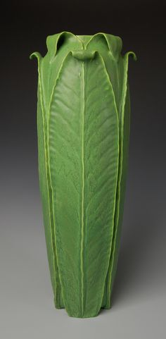 Tall Curled Leaf Vessel - Odd Inq Pottery | #CAPCA. Odd Inq pottery & art tile incorporates the Arts and Crafts aesthetic of both organic and geometric sensibilities. Many of the designs are inspired by Jon White's study of the early 20th century American potters such as Grueby and Teco.
