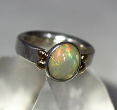 Hey, I found this really awesome Etsy listing at https://www.etsy.com/listing/606331469/firey-welo-opal-ring-set-in-sterling-w