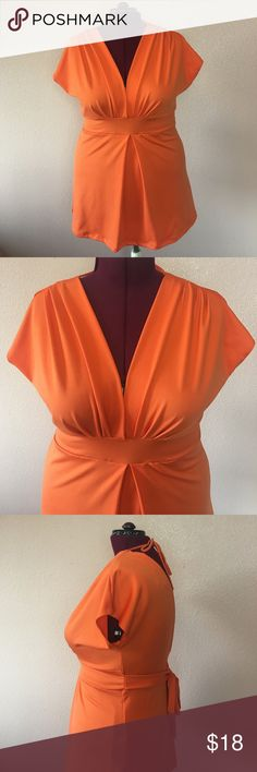 PLUS 2XL V-neck Plunge Stretch Top NWOT gorgeous orange color stretch top.  V-neck plunge front and V-cut open back with sexy tie in the back.  90% polyester, 10% Lycra. Evolution Not Revolution Tops