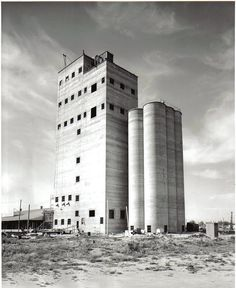 "Old Purina Mill Turlock, CA...these grain towers once were painted with the NuLaid brand name for superior chicken feed.  Thus my family's catchphrase of ""NuLaid, NuLaid!"" as we arrived or departed Turlock to visit our grandparents."