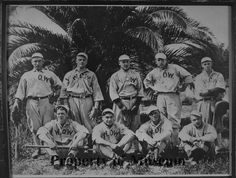 Thanks San Luis Obispo County Historical Society for sharing this photo.  Love this 1915 baseball photo.  Nine members of Woodmen of the World (WOW) baseball team in formal pose: four seated, five standing, palm tree behind. WOW on front of jerseys