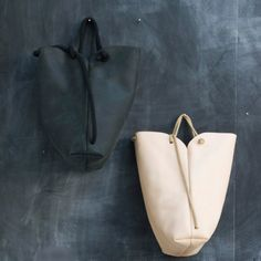 265€ Minimal handmade black or natural leather rucksack turned handbag by adjusting the rope.