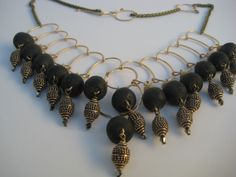 Indonesian black glass w brass bali baroness sparkle drop necklace