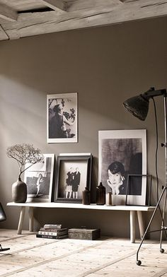 Art wall of large black and white photographs on a gray wall - Gallery Wall Ideas