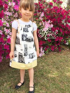 Features a black and white vintage camera print with contrasting geometric yellow. Perfectly paired with a cap sleeve shirt for a cute hipster look. Size 3T-5T (approximate)  Custom embroidery is available. Please message the shop with your ideas for a quote. 100% cotton Exclusive of trims and decorations Handmade in Georgia USA from foreign and domestic materials  *You will receive the item shown. **Colors on screen may appear different from actual physical item due to individual screen…