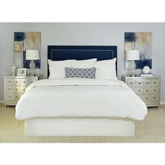 Navy blue, white, and beige/champagne color scheme. Would like it with a beige/champagne headboard, additional blue pillows, and a blue throw at the end.
