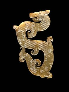 China, Dragon Plaque Pendant with Bird Tail, Warring States Period, 475-221 BCE. Jade