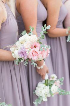 Beautiful bridesmaids wearing lilac and holding lovely little bouquets    #wedding #weddings #weddinginspiration #aislesociety #engaged #classicwedding #realwedding