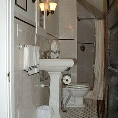 Small, but elegant bath in black and white. | thisoldhouse.com/yourTOH