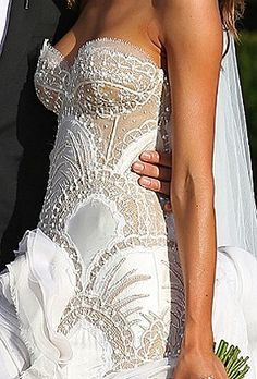 This fitted wedding dress is both sexy and sophisticated. I love the sweetheart neckline with see-through applique on the bodice! #sexy #wedding #dress
