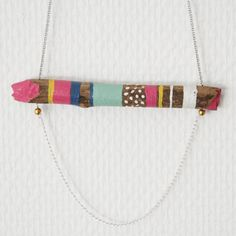 Gorgeous painted wooden neckace. Love the modern aesthetic of this shop! $35