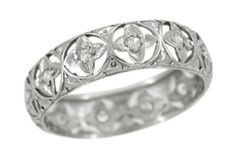 idea for my wedding band... would only have 7 clovers on it for the 7 diamonds clustered in my promise ring