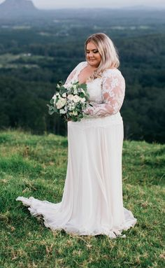 This long sleeve plus size wedding gown has a nice lace bodice. The sheer sleeve adds to the fashion design. Custom Plus size wedding dresses from our firm are affordable. We can even make #replicas of couture designs that will look veey similar to the original but will cost much less. Email us your pictures for pricing. Dariuscordell.com