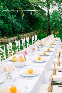 Citrus infused Ibiza wedding tablescape: http://www.stylemepretty.com/destination-weddings/spain-weddings/2015/12/08/citrus-infused-ibiza-wedding/ | Photography: Ana Lui - http://analuiphotography.com/