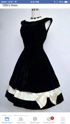 1950s black dress with ivory bow