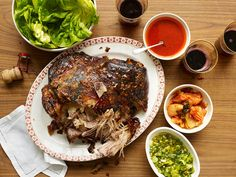 This is a recipe to win the dinner party sweepstakes, and at very low stakes: slow-roasted pork shoulder served with lettuce, rice and a raft of condiments. The chef David Chang serves the dish, known by its Korean name, bo ssam, at his Momofuku restaurant in the East Village and elsewhere. (Photo: Marcus Nilsson for The New York Times)