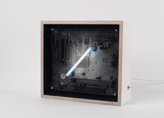 We create [dys]functional spectr-objects using recycled electronics and light. Diagonal, Machine Age, Silver Paint, White Paints, Light Decorations, Wooden Frames, Recycling, Objects, Neon