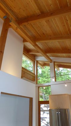 Borsio Modern Timber Frame Home rafters | Artisan Log and Timber Homes