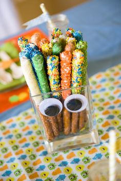 Monster Bash: Adorable monster-print table runner and dipped pretzel sticks in the party colors
