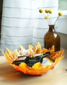 DIY Autumn Leaf Bowl: If you're always misplacing your keys, make this leaf bowl and store it by your entryway so you always have a place to put them.Making this bowl is not only cheap and kid friendly but also a fun DIY craft for the whole family. Get more fun, easy and kid friendly Fall inspired decor ideas here.