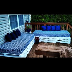 My Pallet Benches AFTER   ***  White Exterior Paint - $20 *** Hospital Mattresses (Water Tight) - $70 *** In/Outdoor Table Cloths For Covers - $30 *** 8 Pillows - $48 *** 6 Pallets - Free  ***  Total Cost = $168 *** Typical Cost of Outdoor Sectional is about 6 times that  ***  Cozy Outdoor Seating For 8 + Comfy Tanning Zone = Priceless