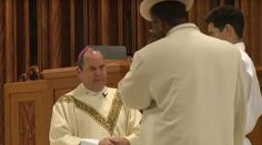 Footage has emerged of the astonishing moment a man in a red suit punched a Newark bishop right in the face during mass before being tackled to the floor.  Auxiliary Bishop of the Newark Archdiocese, Manuel A Cruz was attacked by a churchgoer on Saturday as he was absolving the congregation of sins. Video of the Cathedral Basilica of the Sacred Heart mass shows one attendee casually approach the altar before punching the man of God.  It came moments after Bishop Cruz had uttered the words…