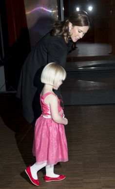 HRH Mary, Crown Princess of Denmark, Countess of Monpezat, returns 5-year-old Anna to her mother after the ceremony.