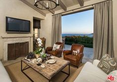 Lady Gaga's Mounted TV over the fireplace which her and Tony Bennett mounted DIY-style in front of the pretty Malibu view.