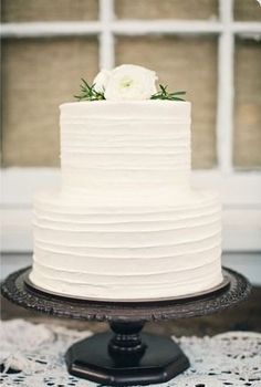 Simple white textured cake with fresh flowers