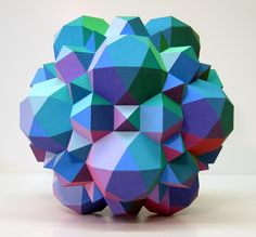 Archimedes, 2003, Form built about a core truncated icosidodecahedron with 12 half icosidodecahedra, 20 half cubeocahedra, and 30 half octahedra.  By Morton Bradley Jr.