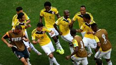 James Rodriguez of Colombia celebrates by dancing with teammates after scoring his team's first goal during the 2014 FIFA World Cup Brazil Group C match between Colombia and Cote D'Ivoire at Estadio Nacional on June 2014 in Brasilia, Brazil. James Rodriguez Colombia, World Cup 2014, Fifa World Cup, Lionel Messi, Soccer Players, Football Soccer, Football Jokes, Football Celebrations, Celebration Dance
