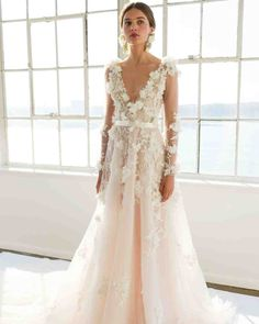 13 Wedding Dresses with Bows | Martha Stewart Weddings - The silk satin ribbon on the waist of this dress ties around the back to create a beautiful bow.