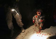 In January 2005, photographerChris Hondros was embedded with the US troops in the northern Iraqi city of Tal Afar; the town had seen frequent clashes between US forces and insurgents, and just after dusk, asthe curfew was coming into force, ared car ignored the warning shots and rushed past the patrol. The soldiers believed that it was a suicide attack, and opened fire.    Inside the car was anethnic Turkoman family rushing to the hospital for a treatment for their ill-son, Rakan; the…