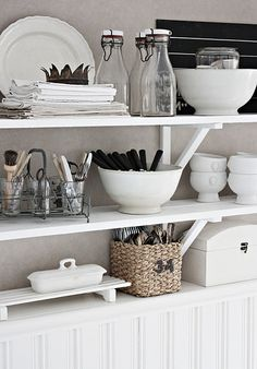 Styling perfection.  White, greys, black glass and linens.  I need open shelving.