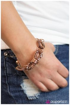 My Main Squeeze - Copper Mismatched copper beads and circles combine into a glitzy bracelet. The focal point of the bracelet is an oval of checkered chain pinched in the center by three copper rings. Accented with two snakeskin chain wreaths, this eye catching bracelet becomes a myriad of copper textures.  Order online at http://paparazziaccessories.com/29861