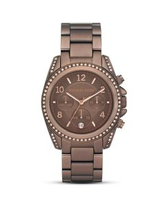 Michael Kors Chocolate Brown Watch.  I tried this on today, and I am in love with it.  I wasn't sure I'd like it on my arm, but I did.  A lot.