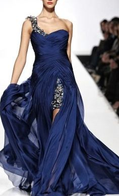 Revealing slit, with intricate lace under...