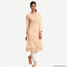 With the latest pastel shades creating all the hype, this minimalistic, Peach to Orange Honeycomb Dobby Embroidered Kurti makes sure you are up to date with the latest trends. Pair this kurti with any palazzos, jeans or leggings of your choice. Visit www.shopnaari.com now! #HouseOfNaari #WeddingShades #BeAllYouCanBe #TrendyBride Indian Skirt, Embroidered Kurti, Pastel Shades, Dobby, Honeycomb, Latest Trends, Wedding Inspiration, Peach, Leggings