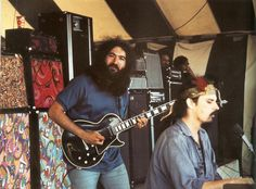 1968, Garcia with a Showman head and two Twin Reverbs. Other Fenders and a couple of Acoustics in the background.